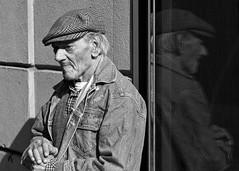 Reflections on life (Daniele Butera) Tags: street old light portrait italy man black hat reflections eyes nikon strada italia novembre day occhi sguardo uomo sicily stick nikkor palermo 2008 riflessi glance ritratto luce sicilia cappello daniele vecchio giorno butera bastone danielebuteracom