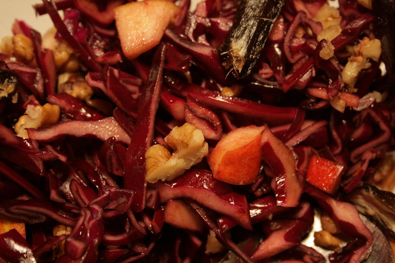 Red cabbage salad with fruits and nuts
