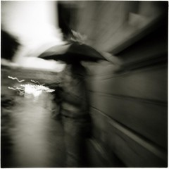 All your troubles (ale2000) Tags: street people urban blackandwhite bw white black blur wet rain umbrella mediumformat square florence blackwhite holga blurry strada gente candid blurvision bn rainy photowalk firenze urbanjungle vignetting pioggia bianco nero biancoenero defocused mosso ilfordfp4 sfuocato ombrelli mrroxymusic bagnato aledigangicom cronacheurbane
