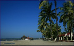 Chaung Tha Beach (Ye Tun.) Tags: travel blue sea sky holiday tree beach canon pagoda sand asia time perspective myanmar earthasia