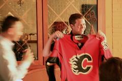Pat Lor gives Garrett a Calgary Flames jersey