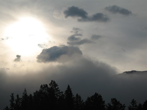 Sun and clouds, the Rockies; a view from The Royal Canadian Pacific