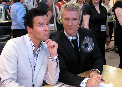 Colin and Justin with silvery blue flower brooch, via Flickr: LexnGer