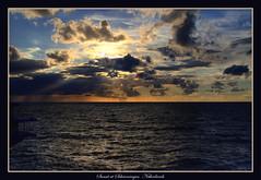Sunset at Scheveningen (tkd.stephen) Tags: sunset sun netherlands clouds canon landscape scheveningen noordzee tamron 30d tamron2875mm canon30d abigfave anawesomeshot sunsetscheveningennetherlands