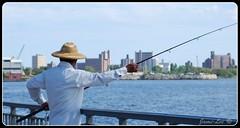 Gone Fishing (jami_lee) Tags: ocean sea sky man water hat buildings fishing nikon hobby lalala fishingpole d60
