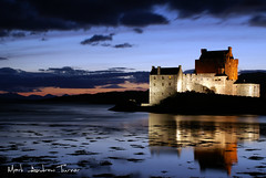 Eilean Donan Castle At Night (Mark Andrew Turner) Tags: light sunset sky reflection castle monument water night clouds landscape scotland mark scottish andrew highland loch turner eileandonan fortified duich dornie lochduich eileandonancastle scottishscenery eileandonanatnight