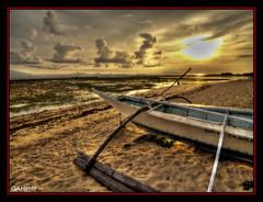 Towards the Setting Sun (gahenty) Tags: sunset sea seascape beach clouds boat raw philippines olympus batangas hdr calatagan luzon banca settingsun e330 zd 3xp 1122mm gahenty outstandingpinoykodakero