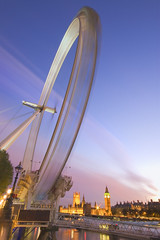 London Eye (canary.wharf) Tags: pink blue london wheel night pier twilight fast londoneye parliament bigben ferris motionblur spinning dri thamesriver sigma1020mm blueribbonwinner supershot nikond40