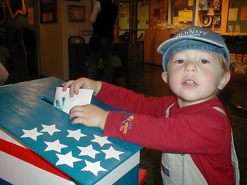 A tot casting a vote at Berkeley's Habitot