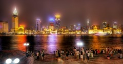 Admiring Shanghai from the Bund (Stuck in Customs) Tags: china lighting people panorama lines night composition buildings reflections river painting photography lights nikon soft shoot photographer shanghai shot angle image details d2x perspective picture away blow fairy edge processing stunning pro glowing dreamy framing portfolio capture shining tale hdr treatment stuckincustoms treyratcliff