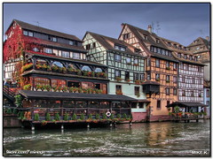 Timber-framed houses in Petite France, Strasbourg (Mike G. K.) Tags: flowers houses windows roof chimney france color reflection fall architecture buildings reflections river restaurant colours pants balcony traditional restaurants strasbourg explore alsace fp dri petitefrance hdr blueribbon abw timberframed photomatix aupontstmartin climbingvine explored explorefrontpage 3exp abigfave habw oct2008 hdrvillage vosplusbellesphotos antibokehwednesday mikegk:gettyimages=invited
