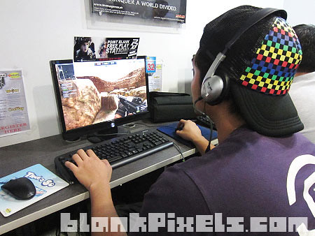 My bro Ken playing Point Blank at Netopia - blankpixels.com