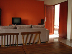 Colors  Living Room on This Deep Orange Works Because Of The Netural Sofa And The Wooden