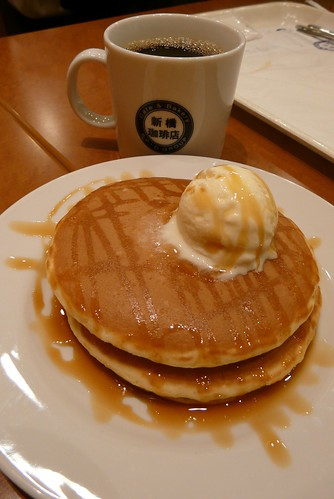 caramel pancakes and a cup of coffee