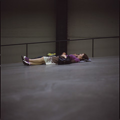Absorption (Society Works) Tags: woman man london 120 6x6 film mediumformat candid tatemodern turbinehall layingdown hasselblad501cm pushed1stop fujichromeprovia400xrxp carlzeissplanar80mmf28cfe