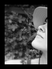 Hat for Norway (IDA Interior LifeStyle) Tags: light portrait bw selfportrait nature hat june garden spring lips noise leafs gaze ilaria canoneos400 inzago