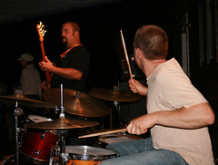 Rocking Out (Shawn Toohey) Tags: party musician usa holiday motion musicians night america drums evening movement drumset doubleexposure livemusic noflash drummer drumming 4thofjuly cymbals drumsticks bassplayer playingdrums