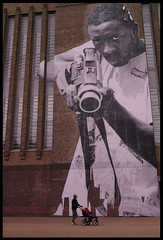 Shoot (Arthur Loveday) Tags: camera uk bw man black london art up modern composition arthur video al holding gun gallery child with image tate paste central magenta parent trick piece visual tones camcorder dwarfed loveday arthurloveday