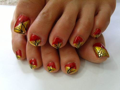 Gold and red nail art designs for toe nails with black grass on nail art pics gallery