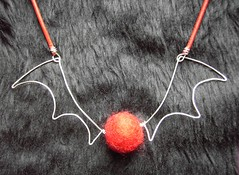 Red Fuzzy Bat - a necklace with silver wings and a felt bead