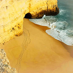 footsteps at the Algarve ( Peter & Ute Grahlmann ) Tags: art beach portugal nature water photoshop sand rocks angle wave sensational algarve 1001nights soe wow1 wow2 wow3 wow4 fiatlux naturesfinest 100faves wow5 50faves wowhalloffame 35faves myowncreation p1f1 favemegroup4 favemegroup6 theunforgettablepictures theperfectphotographer trce lesamisdupetitprince saariysqualitypictures awardedbipg vigilantphotographersunite
