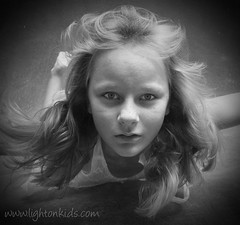look into the deep (david_CD) Tags: girls portrait bw uw wet pool girl face kids female swim children underwater serious dive dramatic bubbles losangles childish softlight jaquelin lightonkids