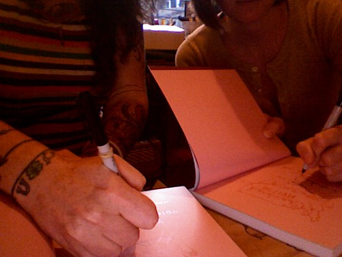 Signing contributor copies of Handmade Nation!