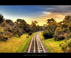 The Lost Highway (II) :: HDR (:: Artie | Photography :: Offline for 3 Months) Tags: trees sky clouds photoshop canon highway cs2 tripod tracks kitlens australia vegetation adelaide grasses express 1855mm curve southaustralia runway efs hdr lanes artie 3xp buslanes photomatix tonemapping tonemap 400d rebelxti
