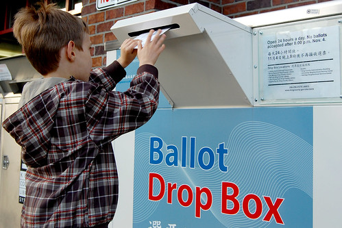 My son, who is 6, putting our ballots in