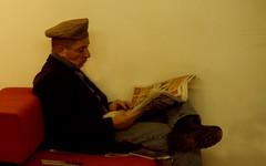 evening news, 1 (lesbru) Tags: portrait painterly london reading newspaper lowlight interior cap nft redsofa 18200mm d40x bficentre