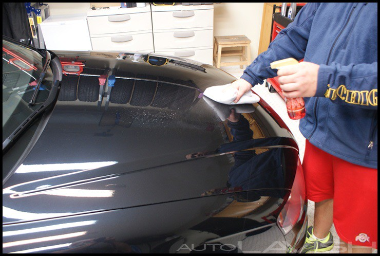 Applying Dodo Juice Red Mist Tropical to a black Audi RS4 in Michigan