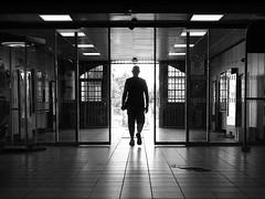 man in black - ( explored ) (mujepa) Tags: blackandwhite bw france station silhouette backlight underpass subway gare noiretblanc nb backlit sortie exit passage lorraine couloir contrejour metz souterrain ringexcellence