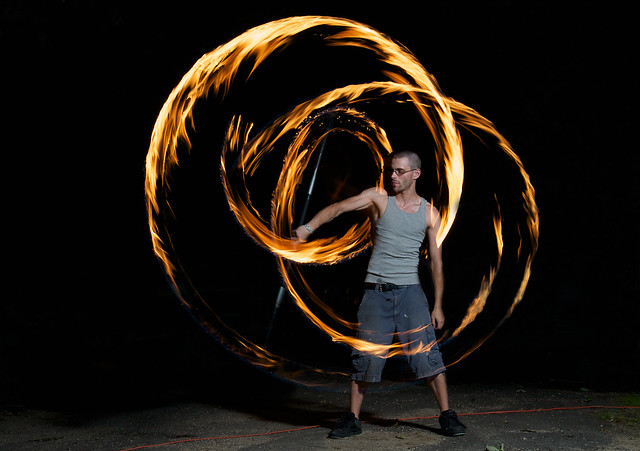 Ray spinning a double fire staff