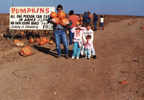 Man carrying pumpkins 1980s