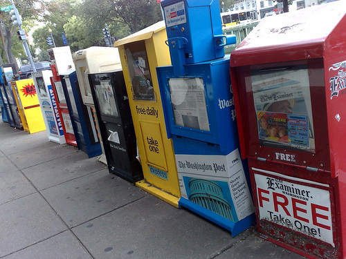 Newspaper boxes stretching from Dupont Circle to the Balitmore Sun
