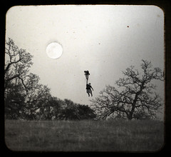 """""""Take me Away"""" (David Parks - davidparksphotography.com) Tags: old camping boy portrait moon david tree oklahoma field night photoshop self dark balloons dead toy fly holga nikon bright parks away full textures scouts string layers prairie campout float hold edmond d40x"""