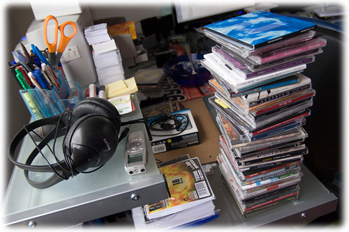 Computerdesk with CDs and headphones