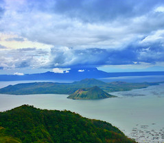 """The Smallest Active Volcano in the World"" (Vic de Vera) Tags: world city travel blue sky lake art nature beautiful clouds painting landscape island photography volcano photo view shot country philippines creative scene spot panoramic crater destination vulcan batangas concept tagaytay eruption wonders smallest fishingvillage luzon taalvolcano talisay aplusphoto theunforgettablepictures vicdevera"