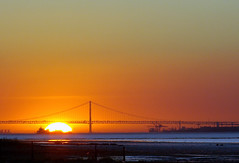 Sun loves bridge (Mario 2R's) Tags: bridge sunset sky sun colors river boat lisbon swamp