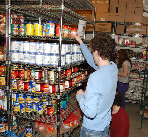 Stocking the Shelves of the West Dide Food Pantry by Jeff French Segall