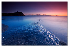 (Claire Hutton) Tags: ocean uk longexposure blue sunset sea england orange moon seascape southwest tower beach wet water rock misty landscape coast purple south hill smooth shoreline pebbles cliffs shore dorset slippery folly kimmeridge afterglow ledges slowshutterspeed purbecks jurassiccoast clavelltower isleofpurbeck