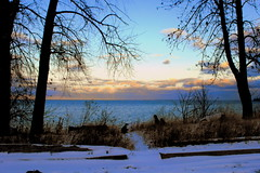 Evening at the Bay (**Ms Judi**) Tags: blue trees sunset sky snow tree water colors up bay weeds branch view sundown path michigan gorgeous branches awesome peaceful scene greenbay serene lovely magical soe breathtaking menominee enchanting beatutiful magicalclouds msjudi mywinners goldstaraward menomineemichigan rubyphotographer judistevenson eveningatthebay cloudsenchanting