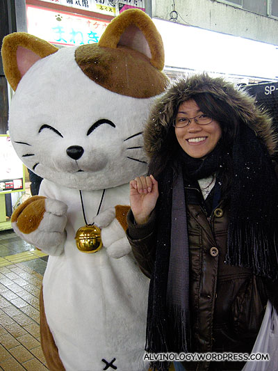 Posing with someone in a neko suit who happened to walk pass us