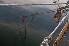 Mast and Rigging Arising From Submerged Fishing Trawler (JohnColeUSA) Tags: ocean sea reflection water different mast fishingboat rigging skyreflection sunkenboat fishingtrawler capecodma unusal submergedboat