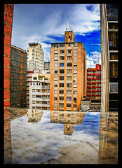 A Puddle... (Fernando Delfini) Tags: blue sky orange distortion storm water colors rain azul clouds canon buildings reflections puddle rebel angle sopaulo barrel wide ivory tint cu fisheye sampa saturation fernando after blocks liquid hdr borders treatment lucisart efs1855 delfini photomatix xti 400d tonalcontrast betterthangood