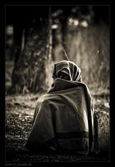 Alone in winter (~ a r u n) Tags: old winter bw india man canon dark l usm hyderabad suffering f4 arun cloaked 70200mm 400d sevakule