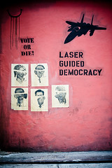 Laser Guided Democracy (Breslow) Tags: newyorkcity red graffiti democracy clinton politics soho elbowtoe obama mccain f15 breslow nikond3