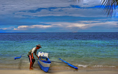 a fisherman and his boat (docjabagat) Tags: sea fun fisherman philippines cebu alcoy banca golddragon