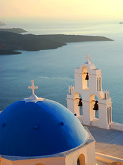 Blue-domed church at sunset (MarcelGermain) Tags: travel blue light sunset sea white building tourism church beautiful architecture bells geotagged greek volcano islands nikon mediterranean european cross religion aegean landmark christian dome orthodox myfavourites thira fira thera firostefani belfries grcia   d80 twtmeblogged aplusphoto theperfectphotographer marcelgermain