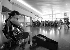 Staten Island Ferry Blues (Artem Portnoy) Tags: nyc bw musician guitar manhattan performance jazz blues streetperformer performer ultrawide statenislandferry strumming 10mm waitingarea sigma1020 southferryterminal jasongreen
